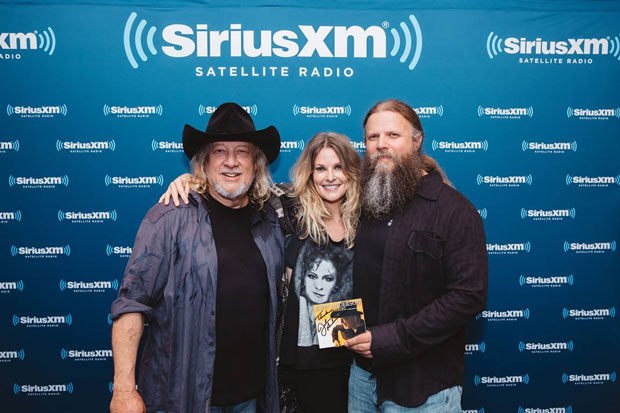 "Elizabeth Cook and Jamey Johnson joined John Anderson for the taping of Sirius XM's Artist Confidential. Anderson was the featured act on Artist Confidential, which aired on Sirius XM's Outlaw Country (Ch. 60). Hosted by Outlaw Country's Elizabeth Cook, the concert showcased Anderson performing new music off his new album as well as some of his greatest hits. Jamey Johnson also made a special appearance and collaborated with Anderson on his classic hit, ""Swingin'."" Pictured L to R: John Anderson, Elizabeth Cook, and Jamey Johnson. Photo credit: Parker Young"