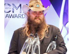 "Chris Stapleton talks to media outlets after winning New Artist of the Year, Album of the Year, and Male Vocalist of the Year at ""The 49th Annual CMA Awards,"" live Wednesday, Nov. 4 at the Bridgestone Arena in Nashville and broadcast on the ABC Television Network. (courtesy of Jamie Schramm/CMA )"