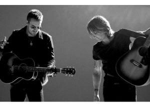Keith Urban & Eric Church sing Raise Em Up