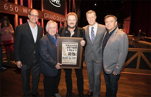 Travis Tritt celebrated his 25th anniversary of becoming an Opry member Tuesday night, February 28. Pictured here L to R: Michael Guth (Opry Entertainment), John Conlee, Travis Tritt, Bill Cody (Opry announcer/650 AM WSM), Dan Rogers (Opry Entertainment) © 2017 Grand Ole Opry / Photos by Chris Hollo