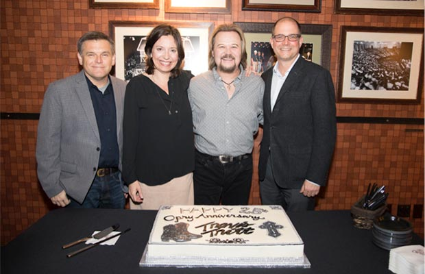 Travis Tritt celebrated his 25th anniversary of becoming an Opry member Tuesday night, February 28. Pictured here L to R: Dan Rogers (Opry Entertainment), Sally Williams (Opry Entertainment), Travis Tritt, and Michael Guth (Opry Entertainment). © 2017 Grand Ole Opry / Photos by Chris Hollo
