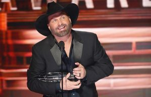 "Garth Brooks accepts a record-extending trophy, claiming his sixth CMA Award for Entertainer of the Year Wednesday during ""The 51st Annual CMA Awards."" Photo Credit: John Russell/CMA"