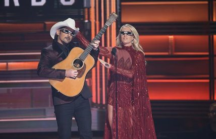 "Brad Paisley and Carrie Underwood celebrate a decade of co-hosting Wednesday during ""The 51st Annual CMA Awards."" Photo Credit: Donn Jones/CMA"